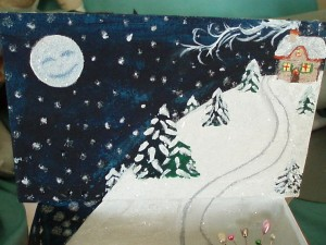 It was a paper mache book. I painted a wintry scene on the inside with lots of glitter.